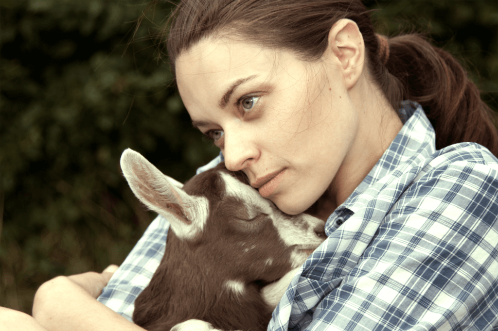 Woman Holding Baby Goat